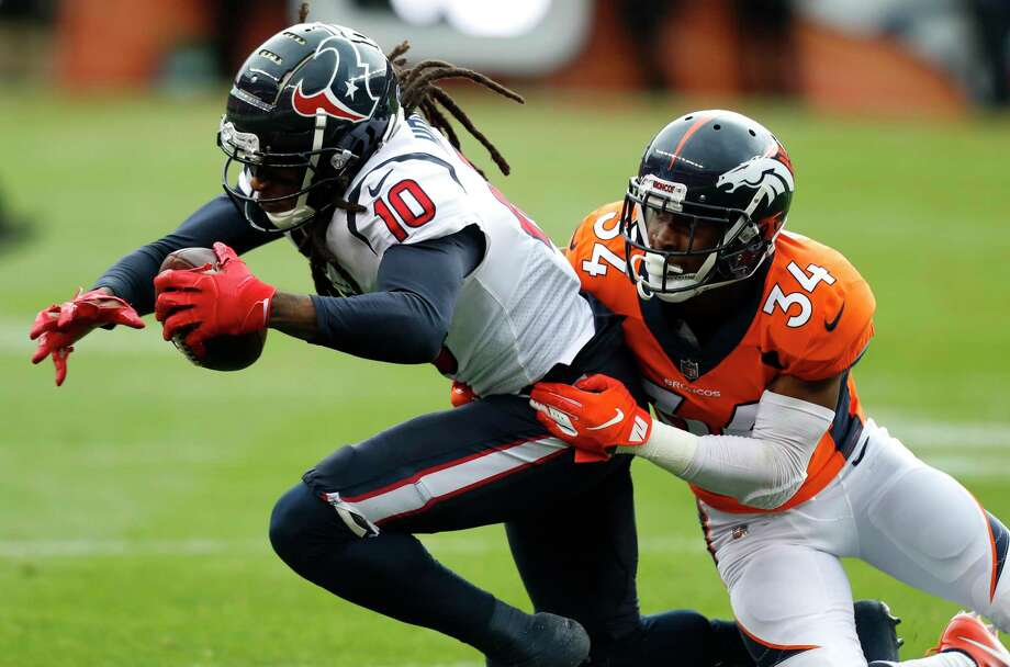 Houston Texans wide receiver DeAndre Hopkins (10) is tackled by Denver Broncos strong safety Will Parks (34) as he makes a first down reception during the first quarter of an NFL football game at Broncos Stadium at Mile High on Sunday, Nov. 4, 2018, in Denver. Photo: Brett Coomer, Staff Photographer / © 2018 Houston Chronicle