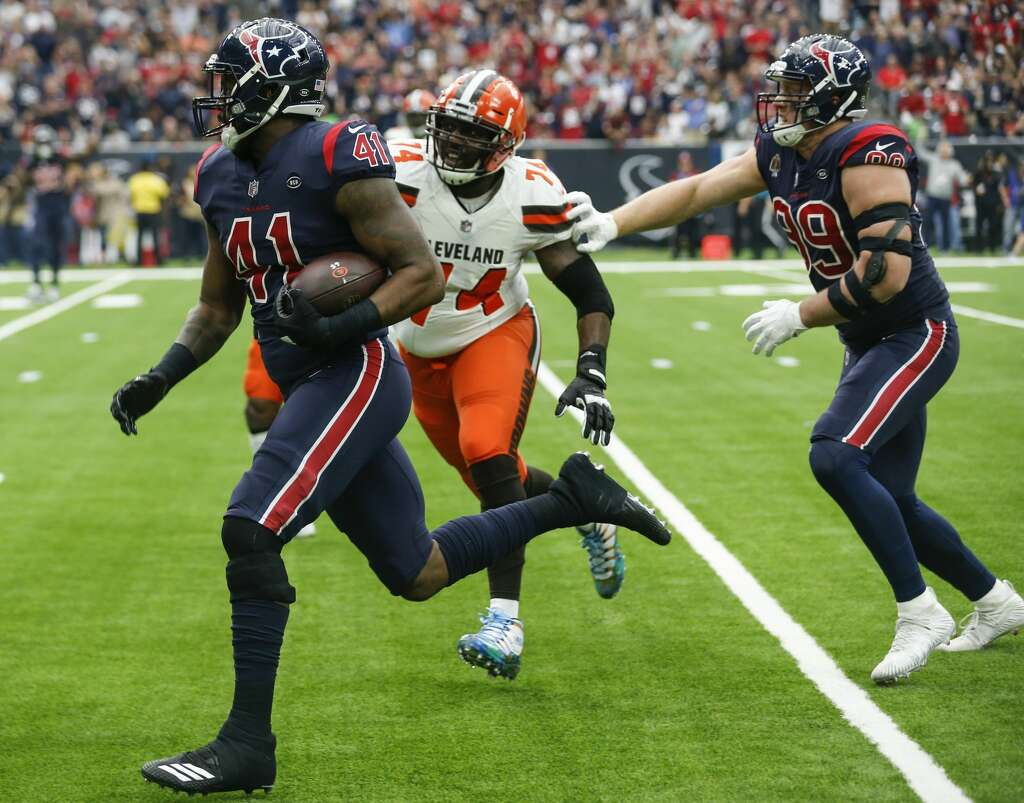<p>Houston Texans inside linebacker Zach Cunningham (41) runs past Cleveland Browns offensive tackle Chris Hubbard (74) for a 37-yard interception return for a touchdown during the second quarter of an NFL</p>