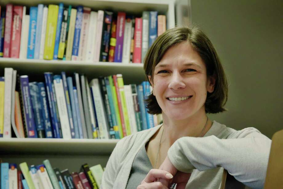 University at Albany Assistant Professor of Management, Lisa Baranik poses for a photo in her office at the college on Tuesday, Jan. 8, 2019, in Albany, N.Y. Baranik studied the psychological impact of government furloughs during the 2013 furlough.  (Paul Buckowski/Times Union) Photo: Paul Buckowski, Albany Times Union / (Paul Buckowski/Times Union)