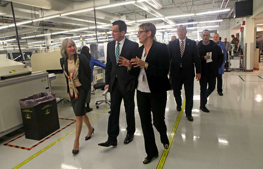 Former Connecticut Gov. Dannel P. Malloy on a 2014 tour of Microboard Processing in Seymour, among some 1,900 companies to receive state financing under Malloy's Small Business Express program. Photo: Unknown / B.K. Angeletti / Connecticut Post freelance B.K. Angeletti