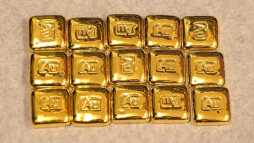 gold turns lower for
