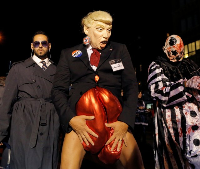 A Person Dressed As Then Presidential Nominee Donald Trump Participates In The Greenwich Village Halloween Parade In Manhattan On October