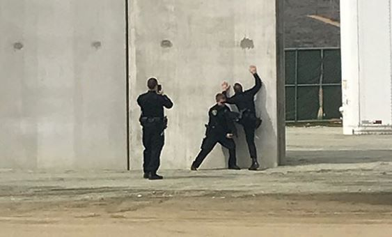 Police Officers Caught Posing Trying to Climb Border Wall
