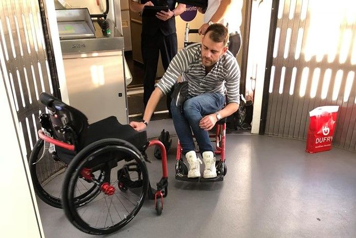 wheelchair man electric lift chairs perth airline calls police on disabled trying to take aboard holiday flight