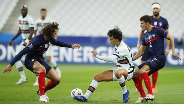 The Portuguese Joao Felix in the middle of the French Adrien Rabiot and Benjamin Pavard.