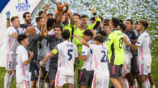 Real Madrid youngsters, accompanied by their coach Raúl, after winning the Youth League on August 25, 2020 against Benfica Lisbon in Nyon, Switzerland.