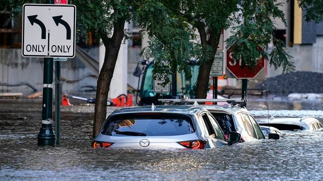 Vehicles are under water during flooding in Philadelphia, Thursday, Sept. 2, 2021 in the aftermath of downpours and high winds from the remnants of Hurricane Ida that hit the area. (AP Photo/Matt Rourke)