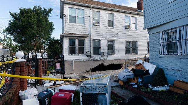 Damage to the side of a building from the remnants of Hurricane Ida is shown on Thursday, Sept. 2, 2021 in the Queens borough of New York. Three people were killed when several feet of water collapsed the wall to their basement apartment and flooded the apartment. (AP Photo/Mark Lennihan)