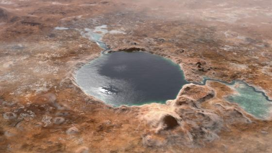 This illustration shows Jezero Crater, the landing site of the Mars 2020 Perseverance rover, as it may have looked billions of years ago on Mars, when it was a lake.  An entrance and an exit are also visible on both sides of the lake.  (NASA / JPL-Caltech)