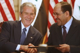 [President George W. Bush and Iraqi Prime Minister Nouri al-Maliki in Baghdad on Sunday celebrated the approval of a security agreement that establishes the basis for a continued U.S. military presence in Iraq.]