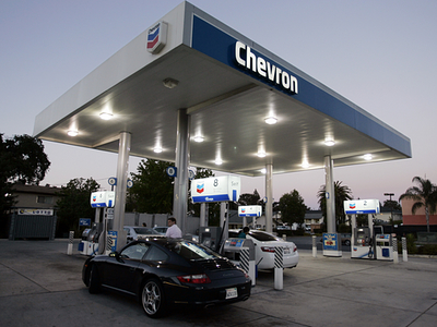 [Record oil prices are boosting the bottom lines of big oil companies like Chevron.]