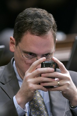 [Assemblyman Chuck DeVore checks his PDA during the debate over a Democratic state budget proposal at the Capitol in Sacramento, Calif., Tuesday, Dec. 16, 2008.]