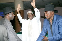 Nigerian President Umaru Yar'Adua (center), with militant leader Victor Ben Ebikabowei, known as Boyloaf (right), announce the surrender of some rebel arms under an amnesty plan on Aug. 7