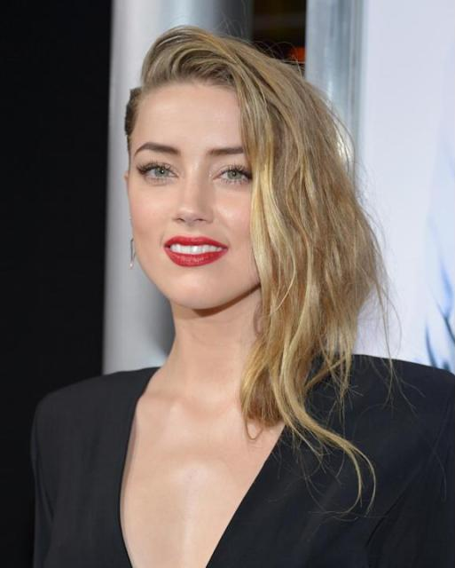 "Amber Heard arrives at the US premiere of ""3 Days to Kill"" at ArcLight Cinemas Hollywood on Wednesday, Feb. 12, 2014, in Los Angeles. (Photo by John Shearer/Invision/AP)"