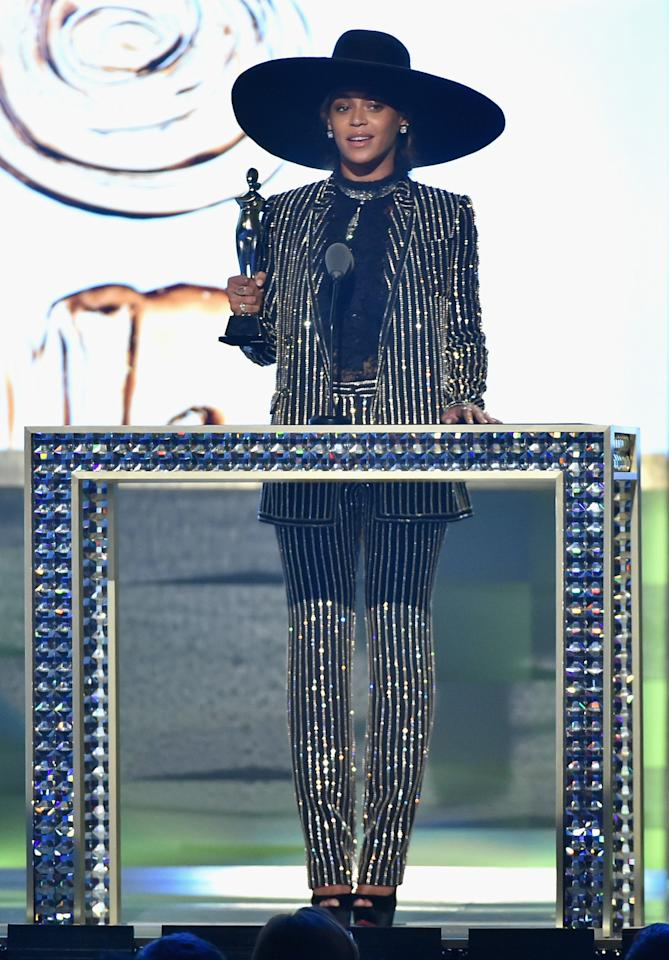 """<p>To accept the CFDA's Fashion Icon Award, Beyoncé, taking a break from Formation World Tour, wore a sequin-striped suit from Givenchy with an oversized wide-brimmed hat. With Jay Z, Blue Ivy, and Tina Knowles in the audience, the <i>Lemonde </i>artist delivered an incredibly powerful speech.""""We have an opportunity to contribute to a society where any girl can look at a billboard or magazine cover and see her own reflection. Soul has no color. no shape, no form,"""" she said. """"Just like all your work it goes so far beyond what the eyes can see. You have the power to change perception, to inspire and empower, to show people how to embrace their complications and flaws and see the true beauty that's inside all of us.""""<i>(Photo: Getty Images)</i></p>"""