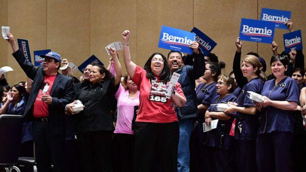 PHOTO: Bellagio hotel workers hold Bernie placards before caucusing at the Bellagio Hotel in Las Vegas, Feb. 22, 2020. (Frederic J. Brown/AFP via Getty Images)