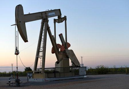FILE PHOTO: A pump jack operates at a well site leased by Devon Energy Production Company near Guthrie, Oklahoma