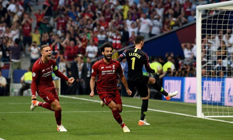 Mohamed Salah (center) gave Liverpool the lead less than two minutes into Saturday's UEFA Champions League final against English rival Tottenham Hotspur, and the Reds never looked back in Madrid. (John Powell/Getty)