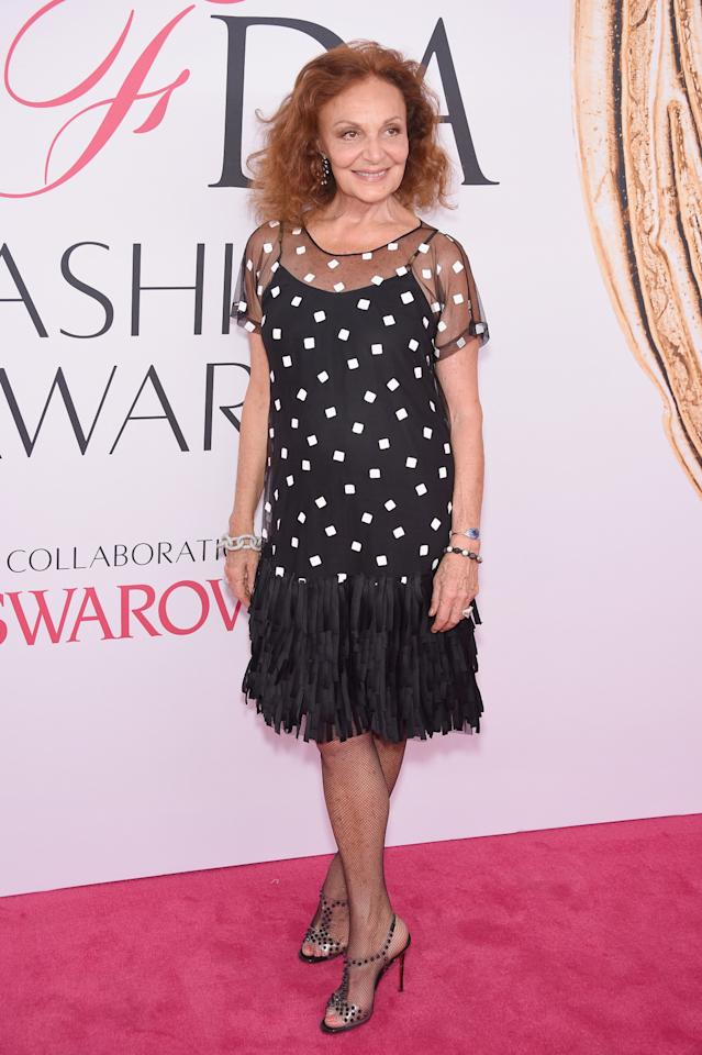 <p>The longtime president of the CFDA paired a polka dot mini dress with a fringe hem with fishnet sticking and plastic heels.<i>(Photo: Getty Images)</i><br /></p>
