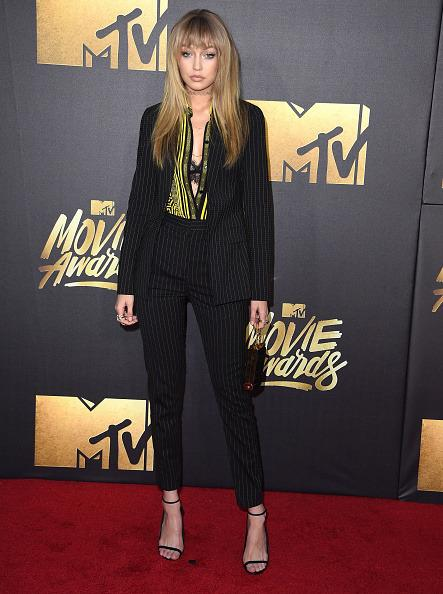 Gigi Hadid in a pin-striped suit and bangs
