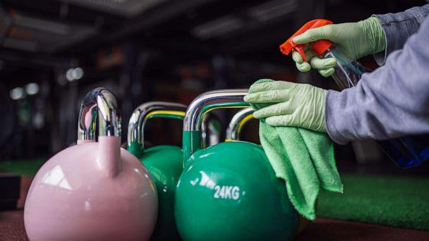PHOTO: A woman cleans and disinfecting equipment in gym without people in this undated stock photo. (STOCK PHOTO/Getty Images)