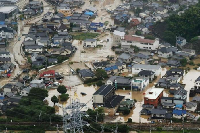 An aerial view of flooded houses in Japan's Hiroshima prefecture (AFP Photo/STR)
