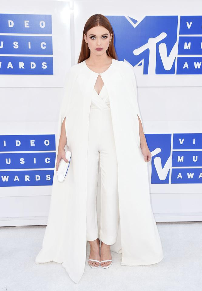 <p>The most popular style on red carpets recently has been rocking a white train — Katy Perry, Solange Knowles, Lady Gaga, and more — and Holland Roden hopped on the train by wearing one with a jumpsuit. <i>(Photo: Getty Images)</i></p>