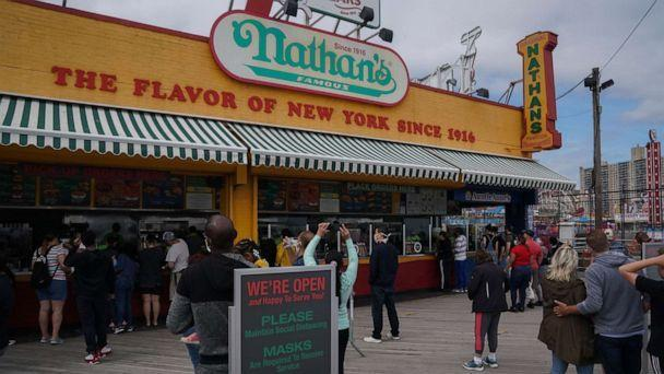 PHOTO: The stand of the famous hot dog Nathan opened at the Coney Island boardwalk during the coronavirus pandemic on May 24, 2020 in New York. (Brian R. Smith / AFP via Getty Images)