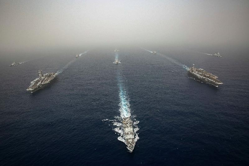 The US aircraft carrier USS Abraham Lincoln -- seen on the left, sailing in formation in the Mediterranean alongside British, French, Spanish and other US warships last month -- has been deployed to the Gulf as tensions with Iran soar (AFP Photo/Jeremiah Bartelt)