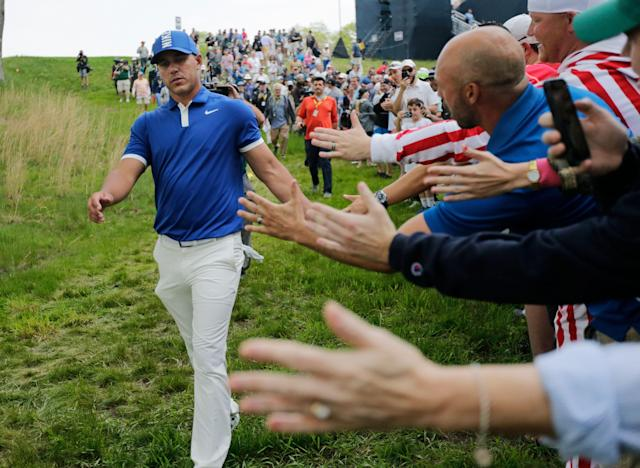 Brooks Koepka greets spectators as he walks down to the 15th tee during the second round of the PGA Championship. (AP)