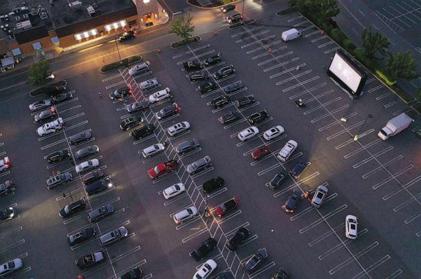PHOTO: In an aerial view from a drone, attendees watch the movie 'The Goonies' at a pop-up drive-in theatre built in the parking lot at the Broadway Commons on May 21, 2020 in Hicksville, N.Y. (Bruce Bennett/Getty Images)