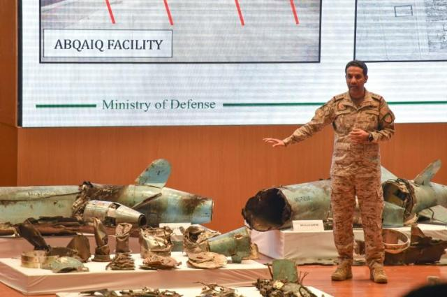 "A Saudi defence ministry spokesman displaying pieces of what he said were Iranian cruise missiles and drones recovered from the attack site that targeted Saudi Aramco's facilities in 2019. A UN report confirmed the weapons were ""of Iranian origin"""