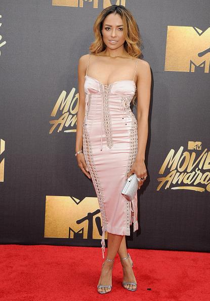 Kat Graham in a pink satin corset-style dress