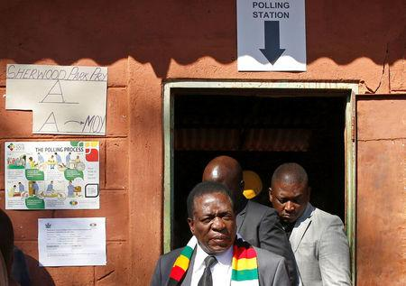 Zimbabwe's President Mnangagwa leaves after voting in the general election at Sherwood Park Primary School in Kwekwe