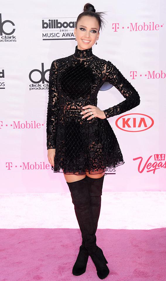 <p>Borrowing a page from the Britney Spears red carpet handbook, presenter Alba donned an adorable black lingerie inspired look.<i><b><br /></b></i></p><p><i>(Photo: Broadimage/REX/Shutterstock)</i></p>