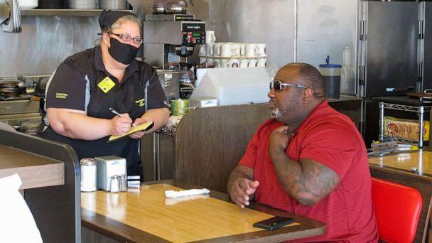 PHOTO: In this photo taken April 27, 2020, a man orders food at the Waffle House restaurant in Savannah, Georgia (Russ Bynum / AP, FILE)