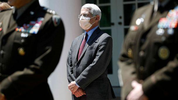 PHOTO: Dr. Anthony Fauci, director of the National Institute of Allergy and Infectious Diseases, listens as President Donald Trump speaks about the coronavirus in the Rose Garden of the White House, May 15, 2020, in Washington. (Alex Brandon/AP)
