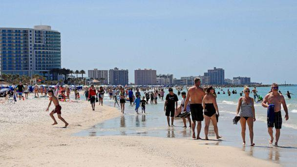 PHOTO: CLEARWATER, FL - MARCH 18: People gather at Clearwater Beach during spring break, despite warnings from world health officials to avoid large groups on March 18, 2020 in Clearwater, Florida. (Mike Ehrmann / Getty Images)