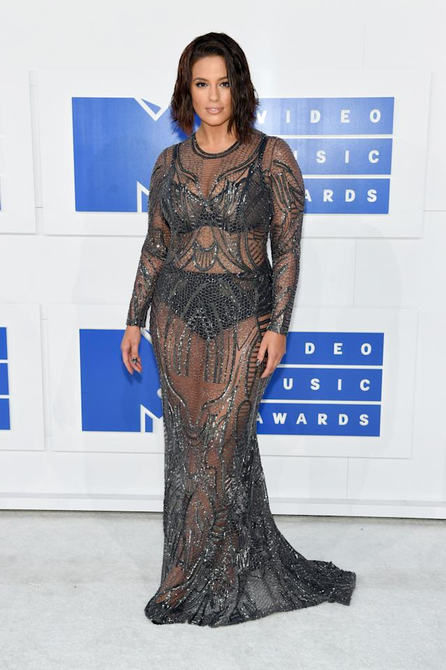 <p>Ashley Graham, who appeared in DNCE's music video and accompanied the band on the white carpet, showed off a new choppy lob with a sheer metallic dress covered in sequins.<i>(Photo: Getty Images)</i></p>