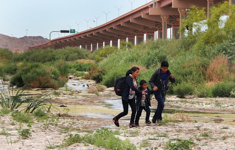 Central American migrants cross the border between Ciudad Juarez, Chihuahua State, Mexico and El Paso, Texas, before being detained by US Customs and Border Patrol agents in May 2019 (AFP Photo/Herika MARTINEZ)
