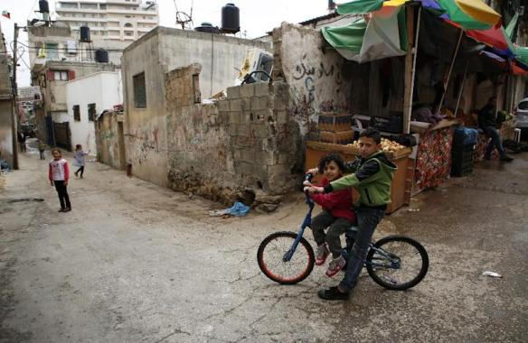 Palestinian children play in the Amari refugee camp near the city of Ramallah in the Israeli-occupied West Bank on May 8, 2018 (AFP Photo/ABBAS MOMANI)