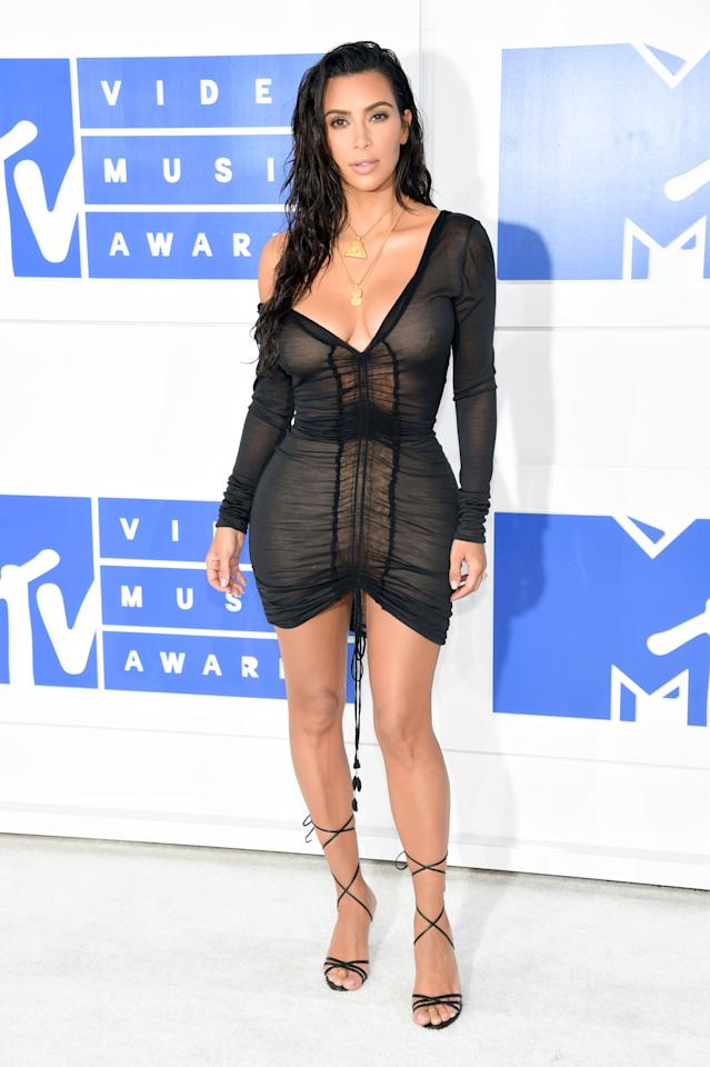 "<p>Kim Kardashian just couldn't decide what to wear so she asked her Twitter followers to help. She asked 47.6 million fans whether she should go with a ""casual chill look"" or a ""dressy sexy look"" and 52 percent voted for the latter. With that, the reality star selected a cotton mini dress with ruching detail in the front and one shoulder purposefully pulled down. She wore lace-up heels and styled her hair in a fresh-out-of-the-shower kind of way. (<i>Photo: Getty Images)</i><br /></p>"
