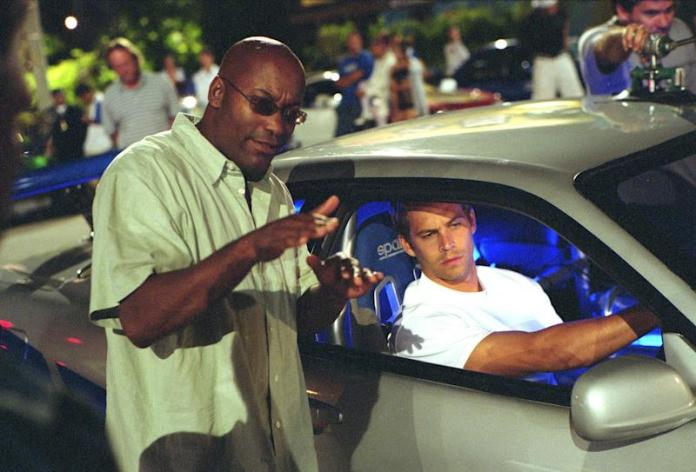 Director John Singleton, Paul Walker on the set of '2 Fast 2 Furious.' (Photo: Universal/courtesy Everett Collection)