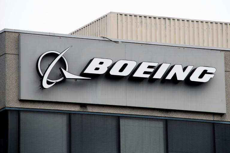 After raising $25 billion in debt from public markets earlier this spring, Boeing did not need to seek support from the US government (AFP Photo/Jim WATSON)