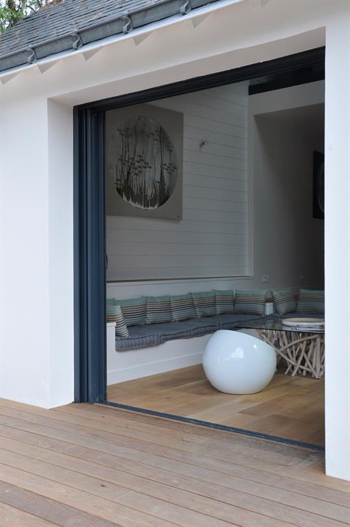 Salon ouvert sur lextrieur Dun Lieu  Lautre photo n10