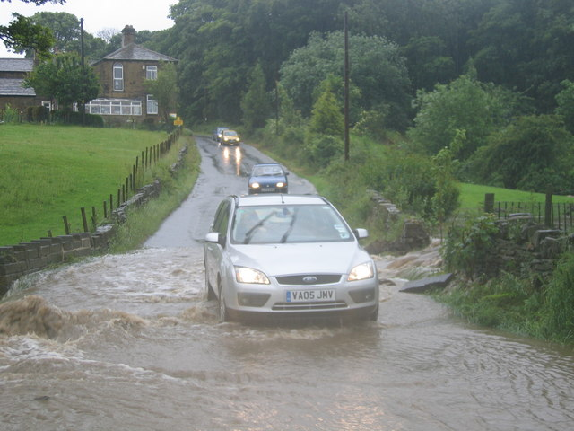 Cars driving through flooded lane in  jobomobo ccby