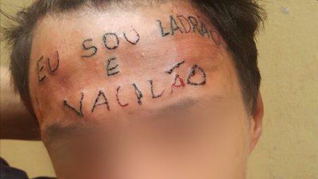 Resultado de imagem para Tatuador é preso por tortura após escrever 'eu sou ladrão e vacilão' na testa de adolescente