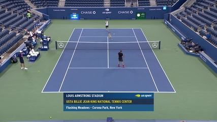 Bruno Soares hits the ball with his son warming up for the US Open match