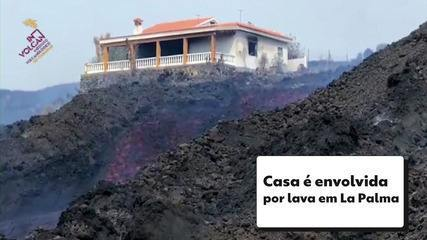 Image shows house being enveloped by lava from the volcano at La Palma