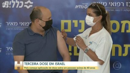 Israeli Prime Minister Naftali Bennett receives the third dose of vaccine from Pfizer as part of a booster campaign to curb the spread of the Delta variant across the country